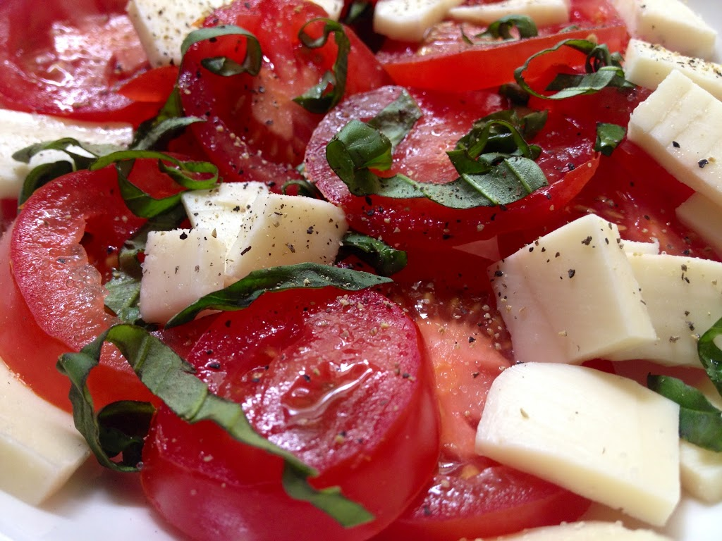 tomatoes, mozzarella, basil, salt and pepper, extra virgin olive oil