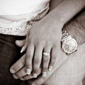 engagement ring and couple's hands