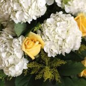hydrangeas and yellow roses