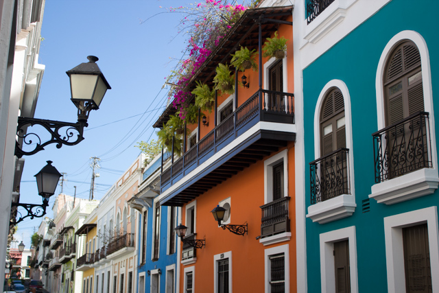 lamp posts and balconies  of vibrant colored buildings in Old San Juan