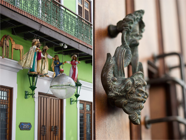 life sized marionettes and oxidized door handle of green building in Old San Juan Puerto Rico