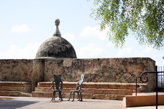 two chairs in front of the Bastion de las Palmas de San Jose in Old San Juan Puerto Rico
