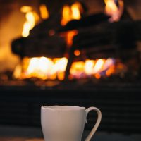 coffe cup and winter fireplace