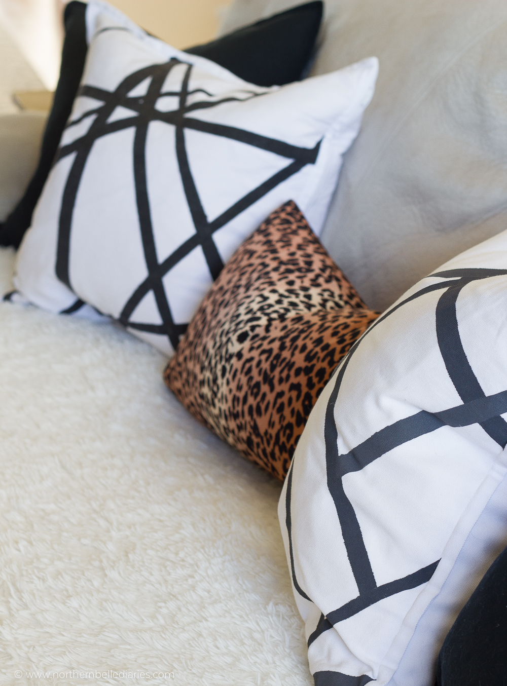 Black and white living room, leopard pillow, grey channels pillow, fiddle leaf fig, and Benjamin Moore Winds Breath