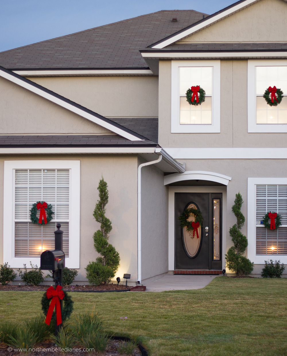 Classic Christmas wreaths with red ribbon on windows and mailbox post #christmas