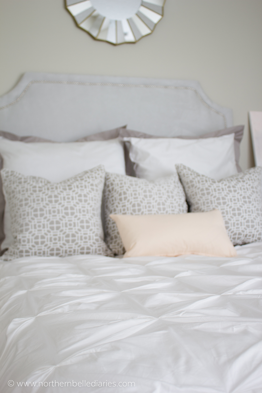 Gorgeous white and grey bedroom with a soft touch of pink. Duvet from Crane and Canopy