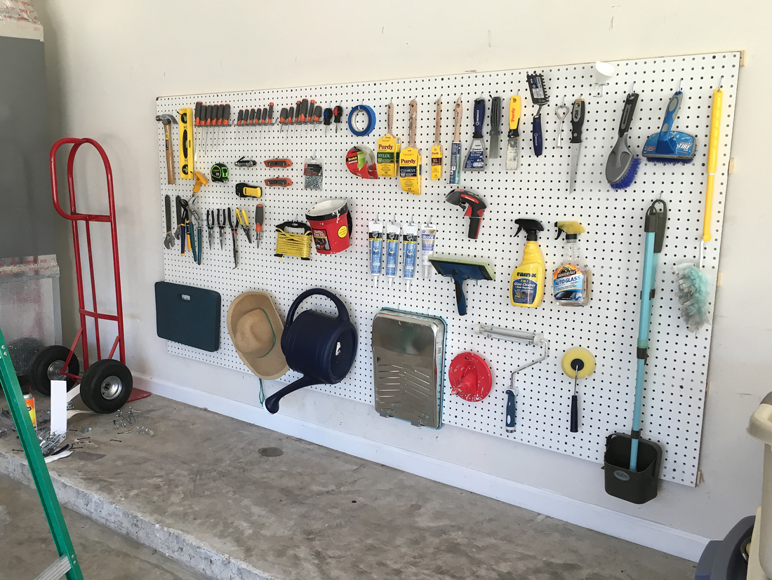 organizing tools in the garage using pegboard