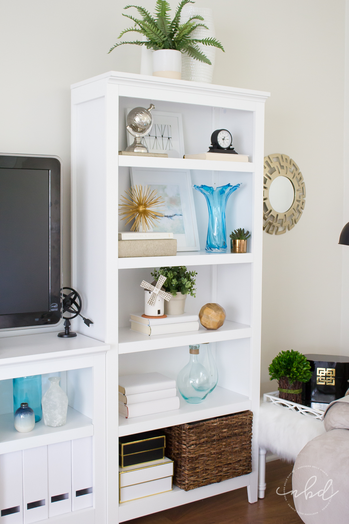 Blue and white bookshelf decorating after styling method by The Decor Fix
