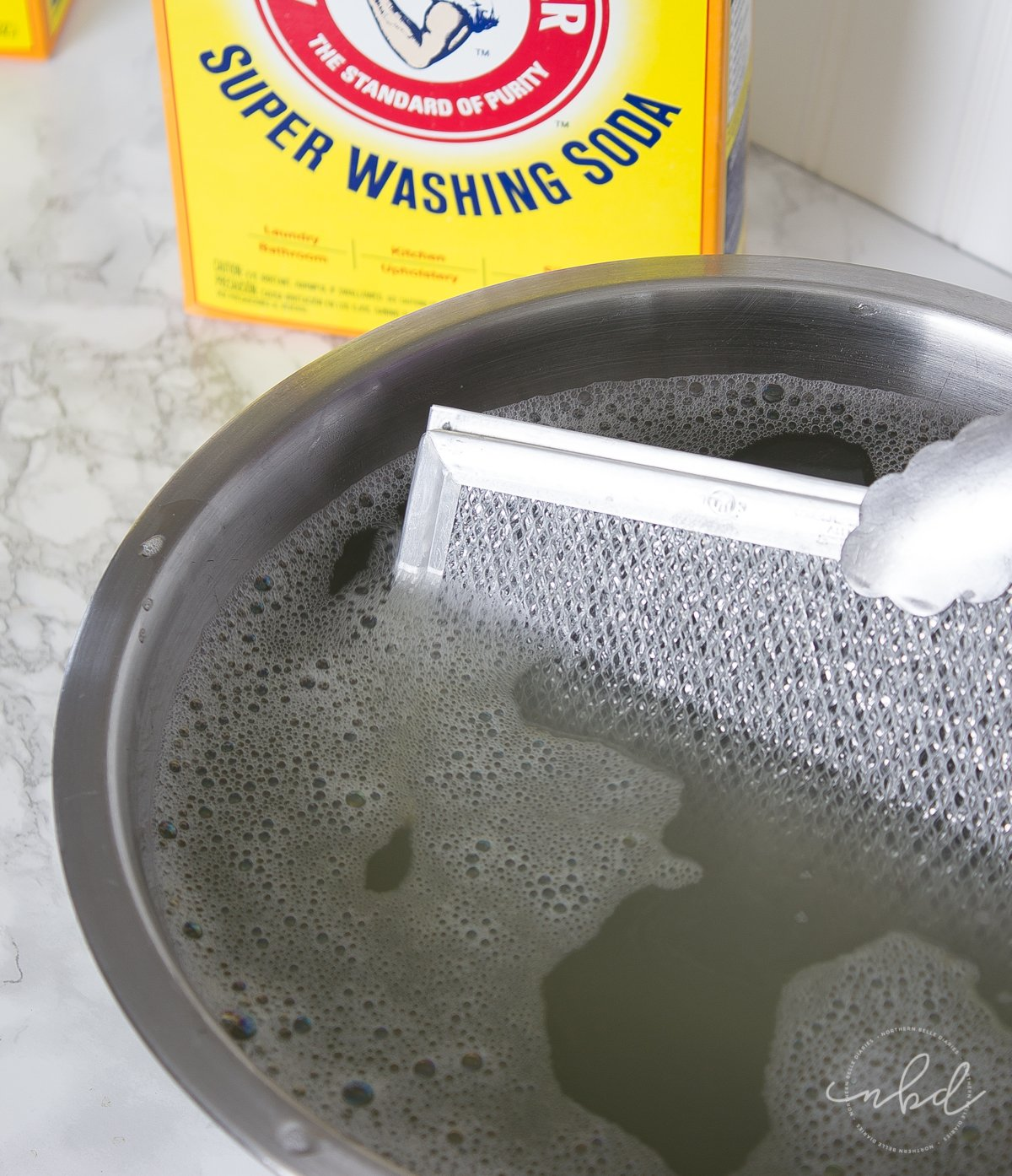 how to clean a greasy range hood filter without scrubbing. Black Bedroom Furniture Sets. Home Design Ideas