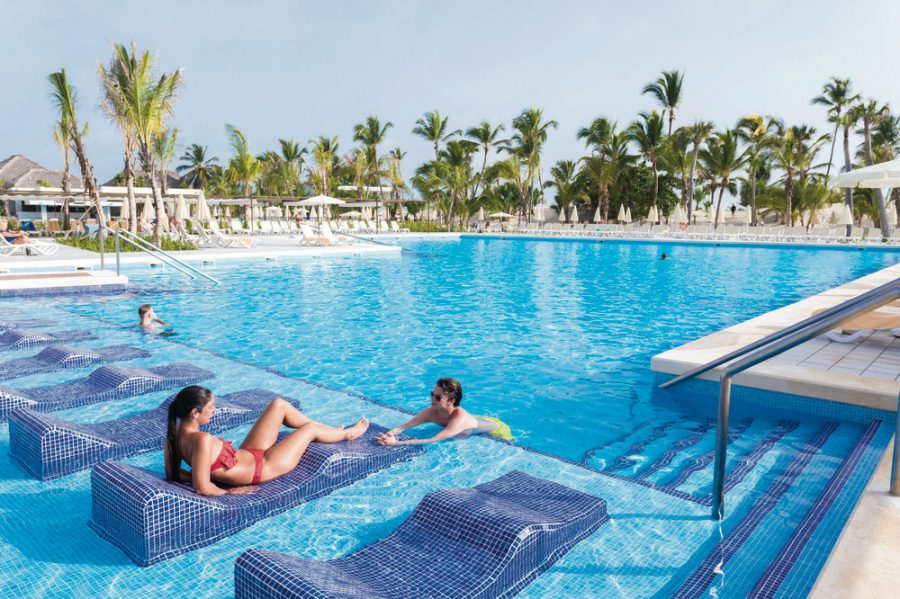 Riu Republica hotel pool with in-pool lounge chairs #TravelWithYourSquad
