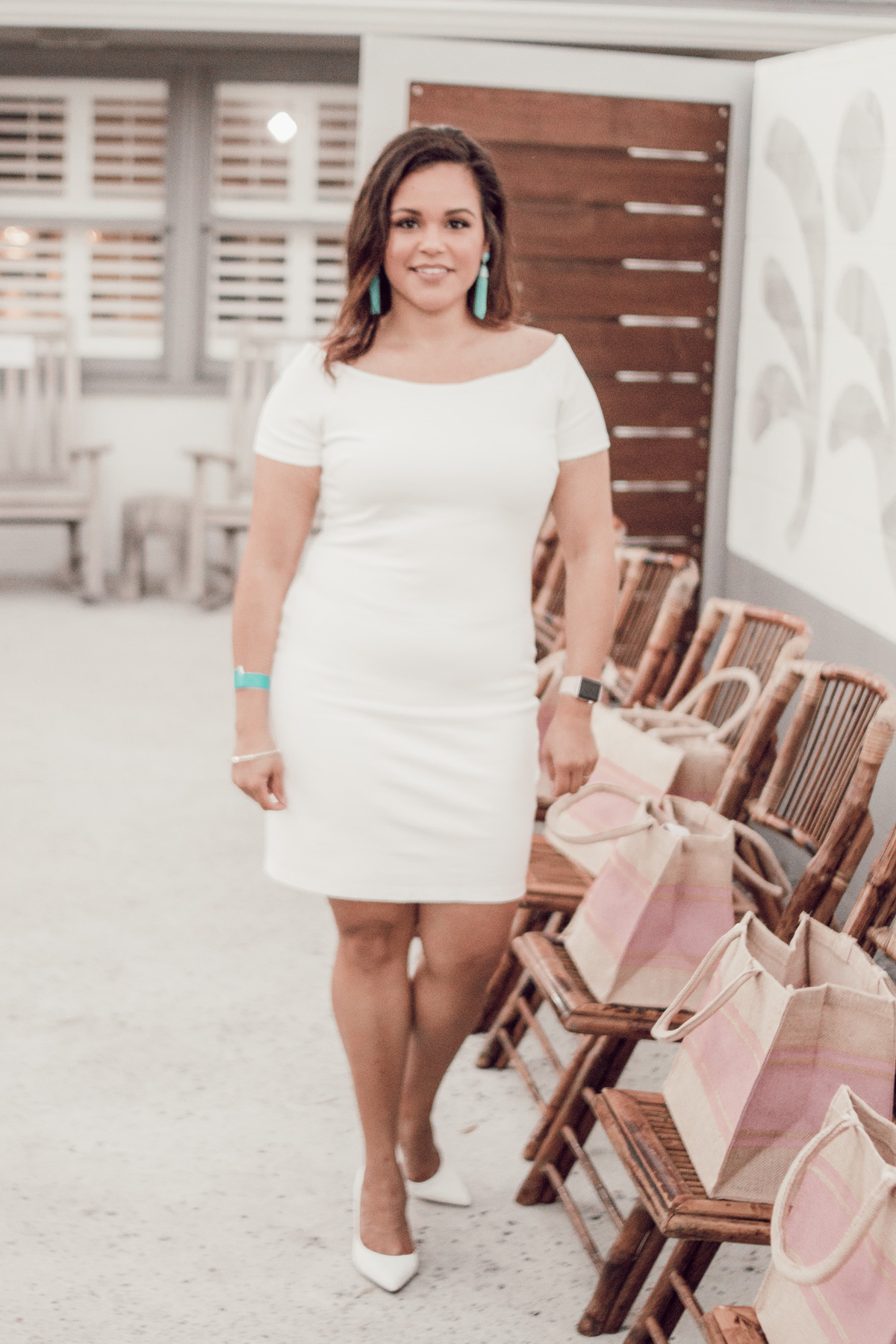 Lisette wearing white bodycon dress