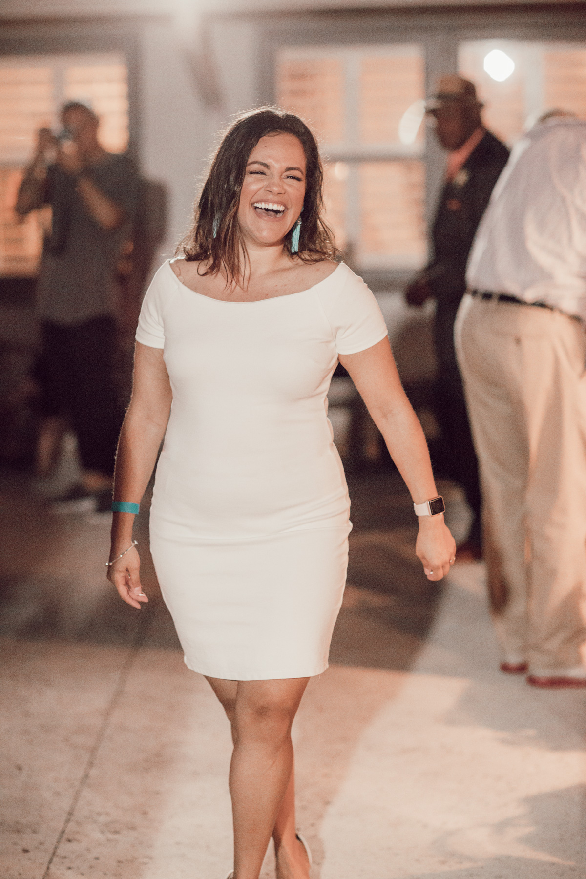 pretty woman in white dress laughing