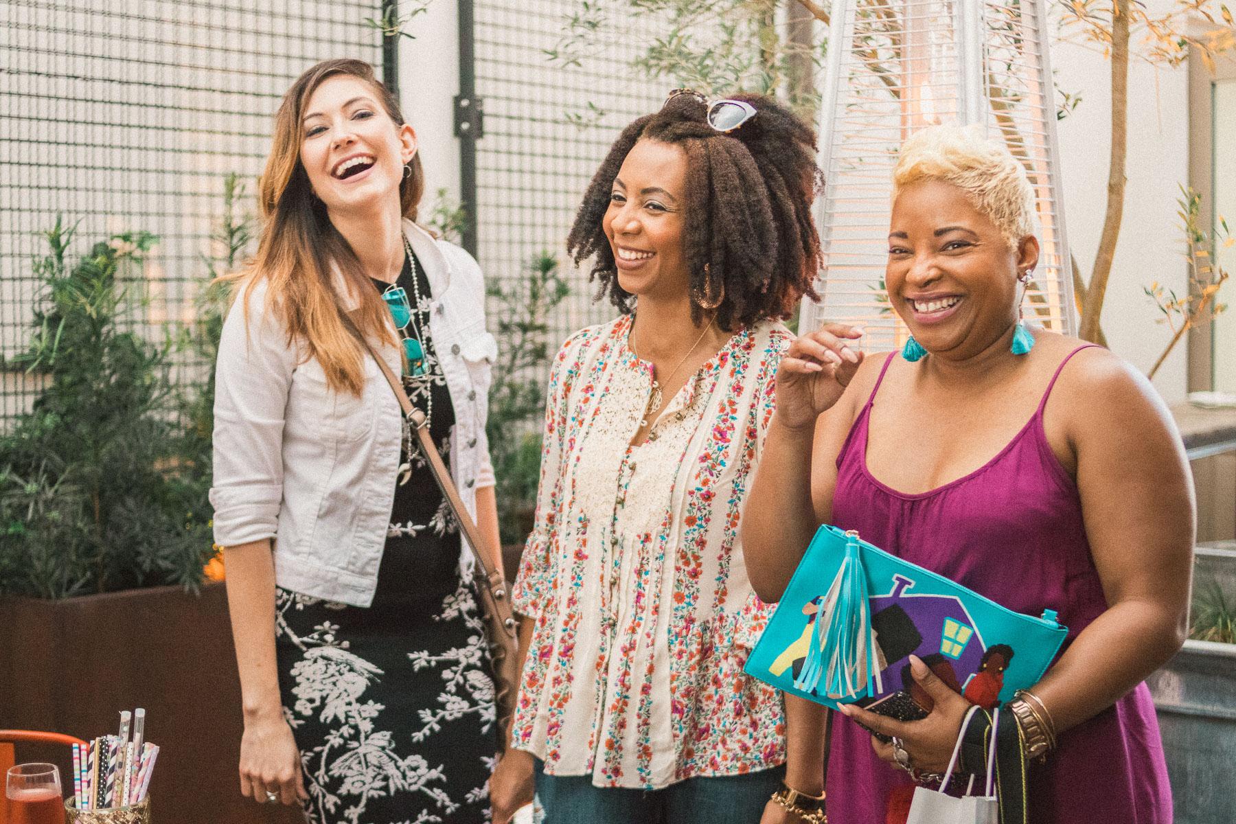 three North Florida bloggers laughing