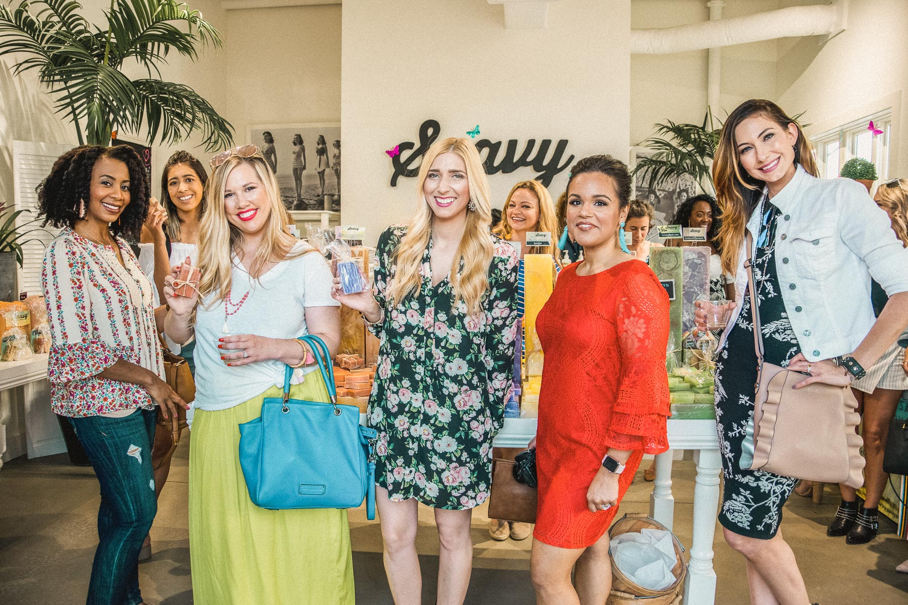 bloggers and influencers standing in Saavy Naturals strefront