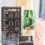 LASH Jax rate sheet next to champagne