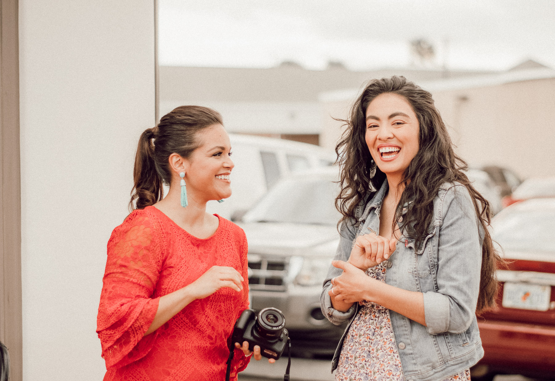 two Latinas laughing