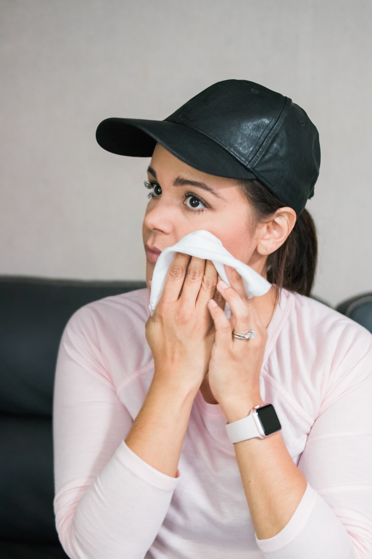 woman removing makeup with Neutrogena makeup remover cloth