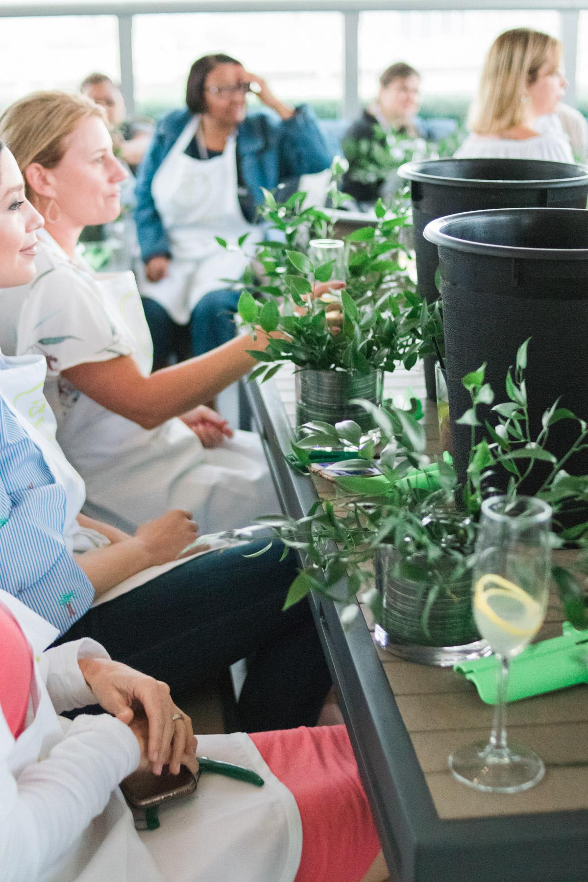 women making flower arrangements during Alice's Table workshop in Jacksonville, Florida