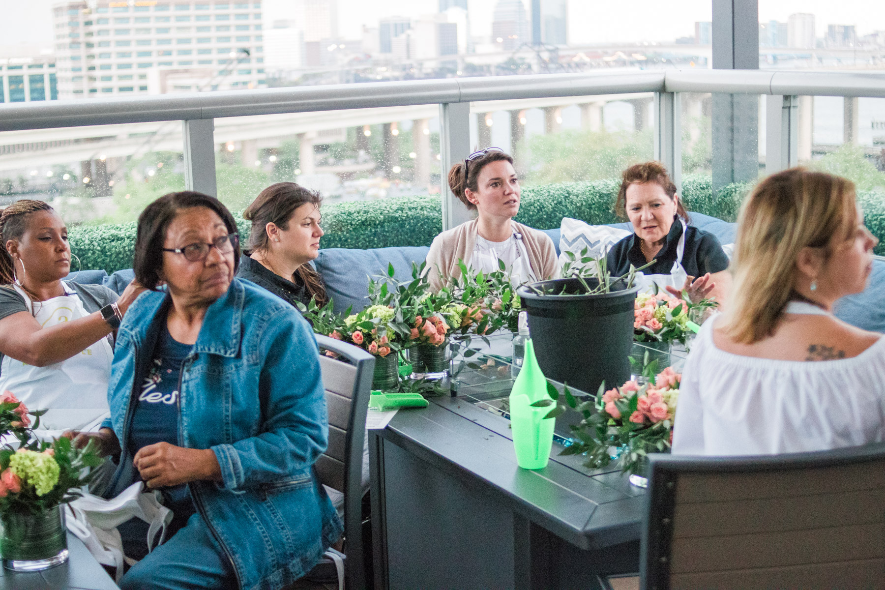 women learning about making flower arrangements during Alice's Table workshop in Jacksonville, Florida