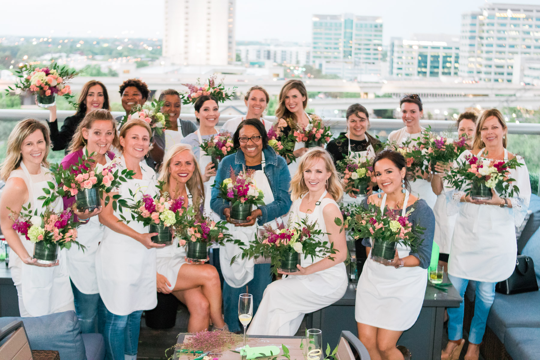 women smiling with their flower arrangements after Alice's Table workshop in Jacksonville, Florida