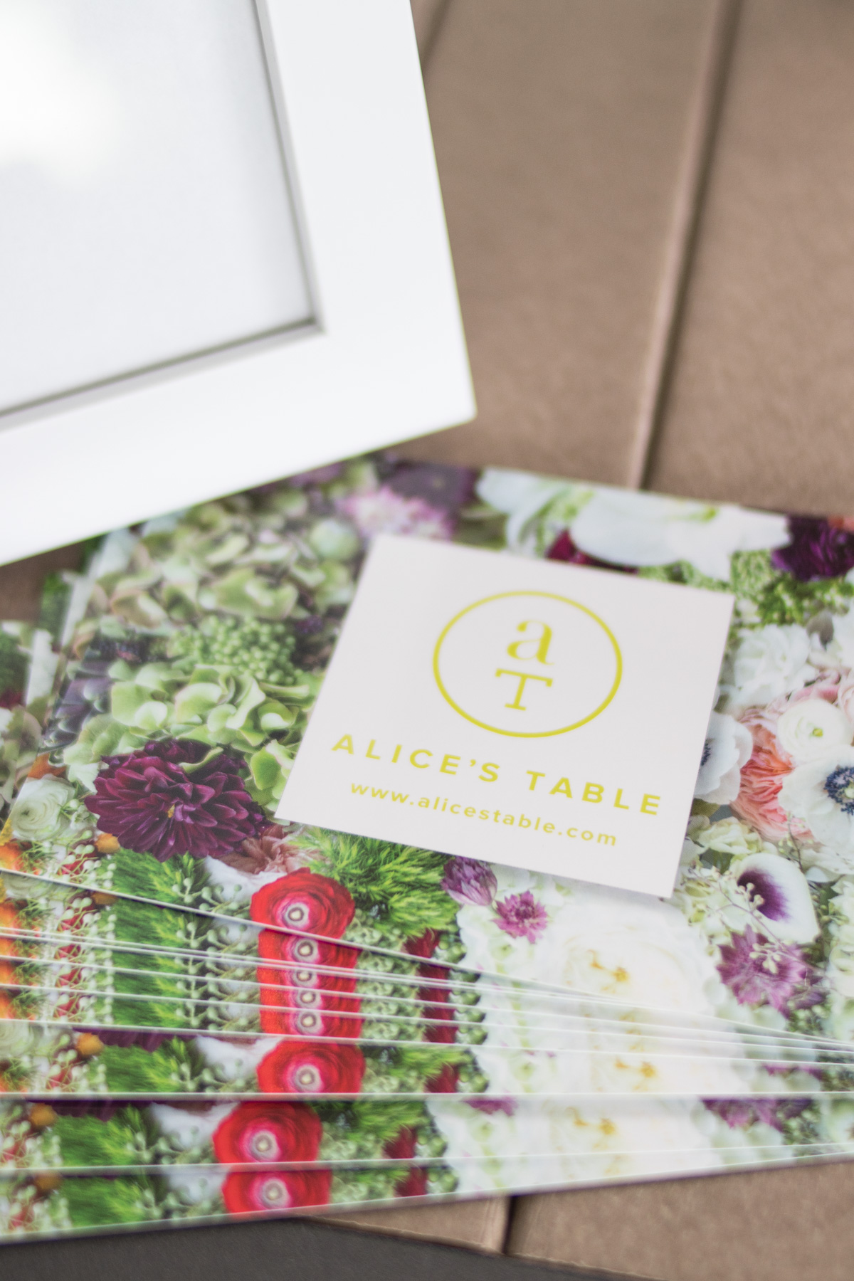 postcards with Alice's Table logo and website