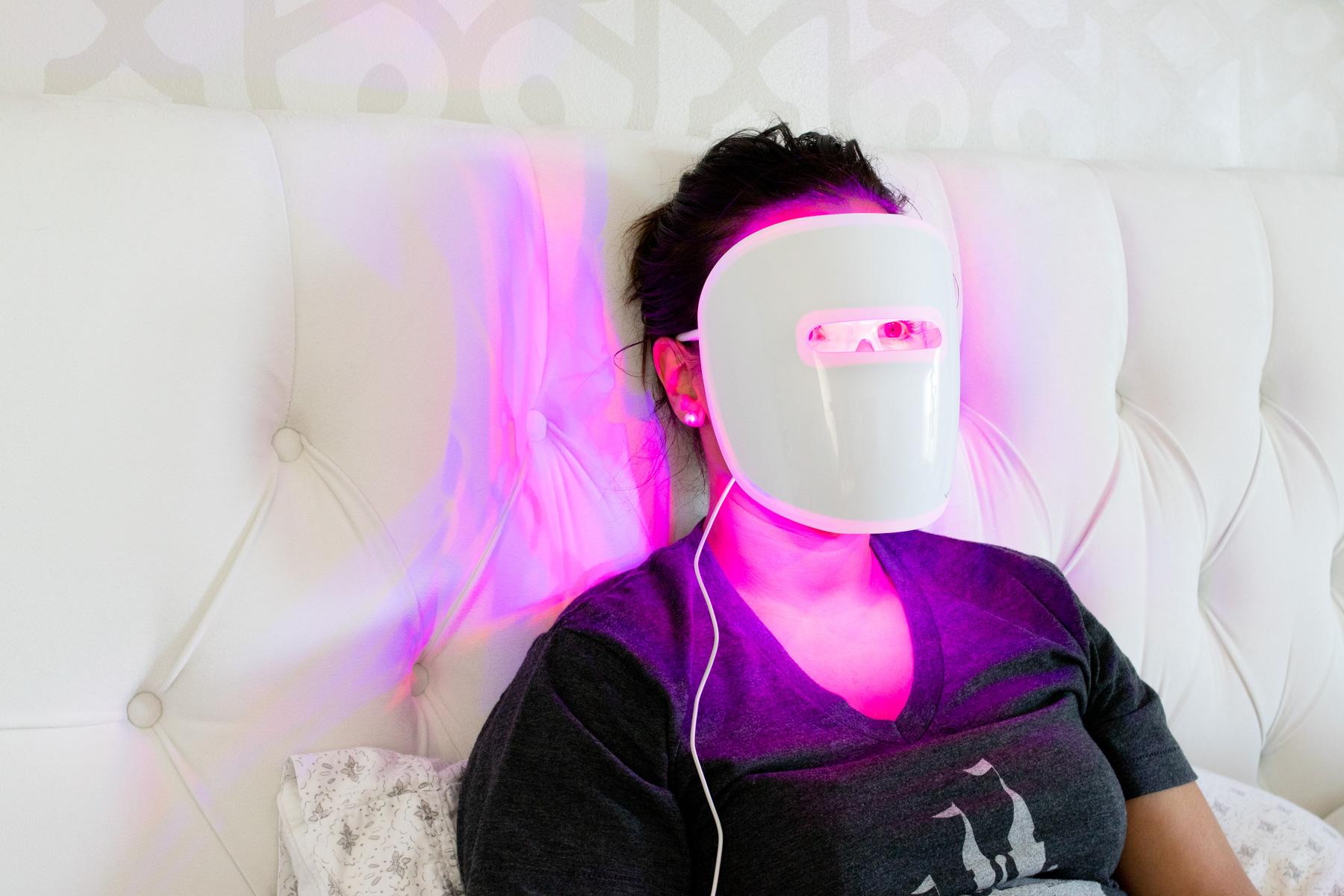 woman wearing Neutrogena Light Therapy acne mask