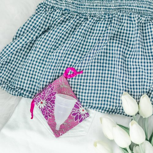 white jeans and gingham top with DivaCup menstrual cup