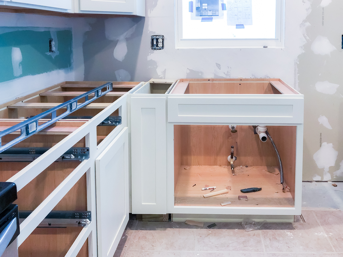 9 inch cabinet face frame and door installed onto cabinet base
