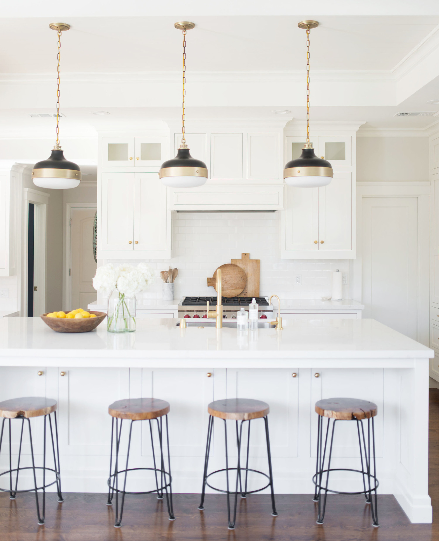 white kitchen with three pendants over island