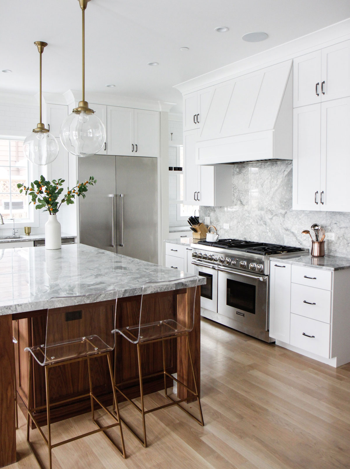 white kitchen with wood tone island