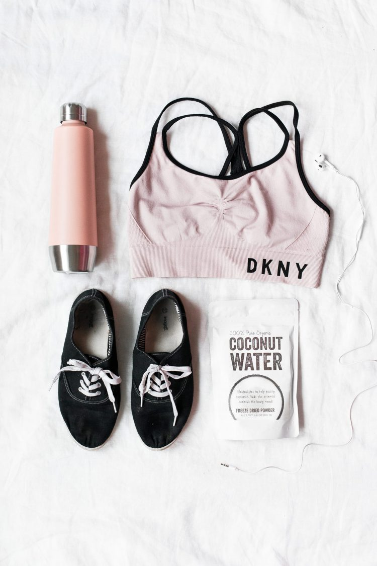 pink fitness clothing, shoes, and water bottle