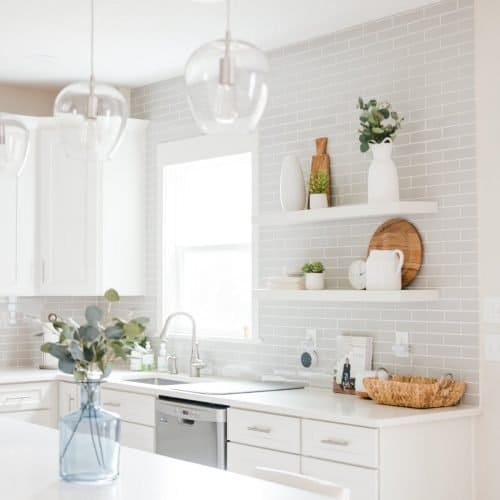white shaker kitchen with gray subway tiles and open shelves