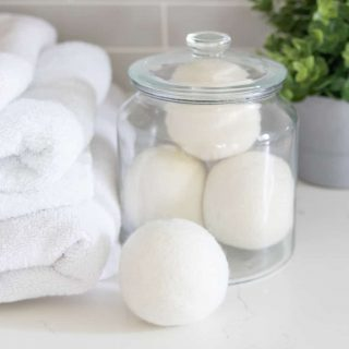 wool dryer balls in glass apothecary jar